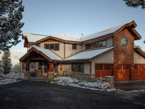 DePrez-Beck Off-Grid Residence Exterior with 3-bay Garage