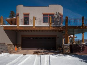 Krumme Upper Garage tucked under wrap around porch, Mountain Territorial Style